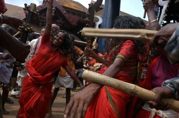 Vellichappadu (woman Oracle ) performing to the tune at Kodungalloor Temple, Kerala
