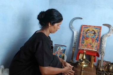 Vellichappadu (woman Oracle ) performing at her temple in side house in Palakkad, Kerala
