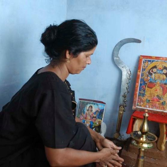 Vellichappadu (woman Oracle ) performing at her temple in side house in Palakkad, Kerala