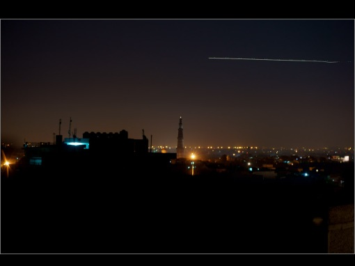 in Mehrauli village: aircraft flying over Qutub Minar, New Delhi